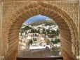 Ornate Window at the Alhambra showing view of Granada, Spain